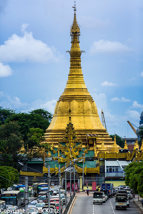 04 JUNE 2014 - YANGON, YANGON REGION, MYANMAR: Sule Paya (Pagoda) in central Yangon, Myanmar (Rangoon, Burma). Sule is thought to be 2,000 years old and is the point from which distances and coordinates from which all distances to the north are measured. Yangon, with a population of over five million, continues to be the Myanmar's largest city and the most important commercial center.     PHOTO BY JACK KURTZ