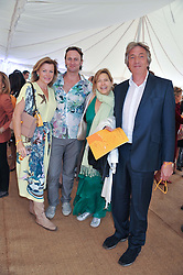 Left to right, EIMEAR COOK, VINCE LEIGH, PENNY SMITH and NICK COOK at the 2012 Veuve Clicquot Gold Cup Final at Cowdray Park, Midhurst, West Sussex on 15th July 2012.