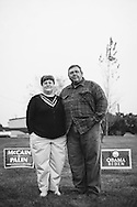 Junior Harris (right) an Obama-Biden supporter and his wife, Kay Harris, a McCain-Palin supporter, outside their home in Edgar Springs, Missouri. The couple's property borders the marker naming Edgar Springs the center of the U.S. population, as determined by the U.S. Census Bureau.