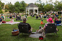 "Jan and Kevin Keady  with their dog ""Ellie"" sit amongst the crowd enjoying the soulful sound of Sharon ""Sugar"" Jones during Thursday evenings Concert by the River at Rotary Park.  (Karen Bobotas/for the Laconia Daily Sun)"