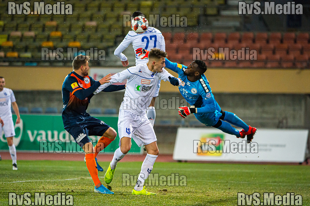 LAUSANNE, SWITZERLAND - NOVEMBER 22: #27 Dan Ndoye of FC Lausanne-Sport tries to score against #43 Goalkeeper Anthony Mossi of FC Wil during the Challenge League game between FC Lausanne-Sport and FC Wil at Stade Olympique de la Pontaise on November 22, 2019 in Lausanne, Switzerland. (Photo by Robert Hradil/RvS.Media)