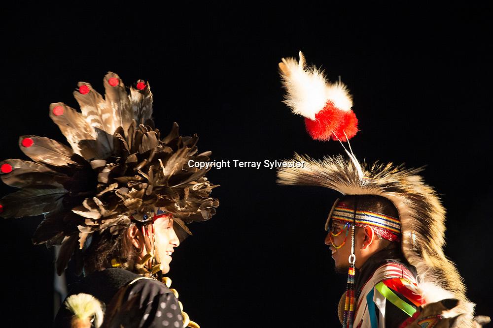 Oglala Lakota fancy dancers talk during a performance in the opposition camp against the Dakota Access oil pipeline on September 18, 2016. Cannon Ball, North Dakota, United States.