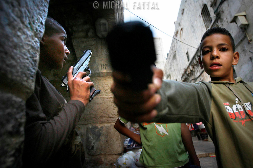 Palestinian children play with plastic toy guns to celebrate Eid al-Fitr in the Old city of Jerusalem, October 14 2007. Eid al-Fitr is the end of the Muslim holy month of Ramadan