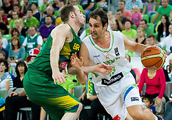 Marcelo Huertas of Brasil vs Domen Lorbek of Slovenia during friendly basketball match between National Teams of Slovenia and Brasil at Day 2 of Telemach Tournament on August 22, 2014 in Arena Stozice, Ljubljana, Slovenia. Photo by Vid Ponikvar / Sportida