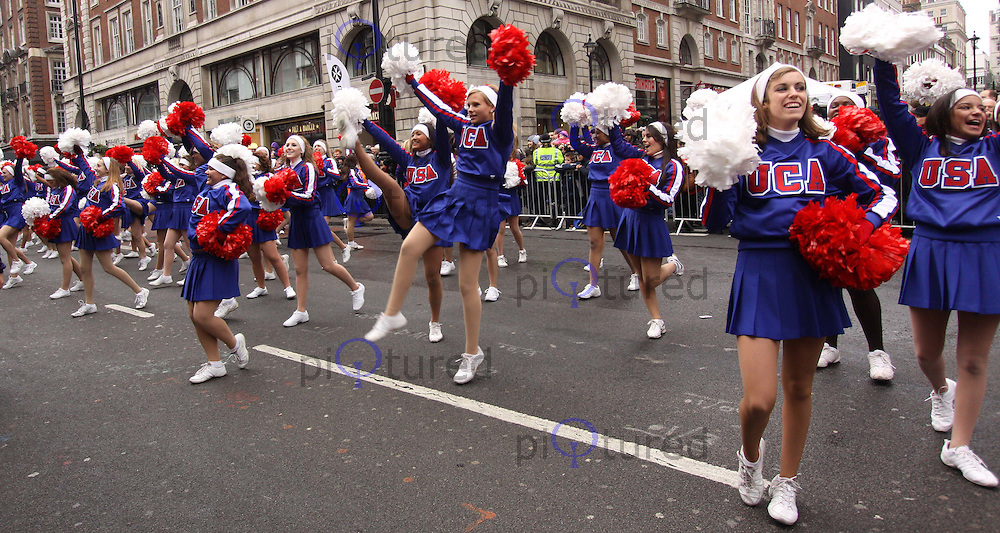 Universal Cheerleaders Association London's New Year's Day Parade, City of Westminster, London, UK, 01 January 2011:  Contact: Ian@Piqtured.com +44(0)791 626 2580 (Picture by Richard Goldschmidt)