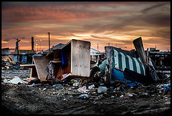 October 27, 2016 - Calais, Northern France, France - Image ¬©Licensed to i-Images Picture Agency. 27/10/2016. Calais, France. Calais Jungle Migrant Camp. Last few remaining refugees walk around what is left of the Calais Jungle migrant camp after bulldozers have torn it apart all day. As the French police close it down. Picture by Andrew Parsons / i-Images (Credit Image: © Andrew Parsons/i-Images via ZUMA Wire)