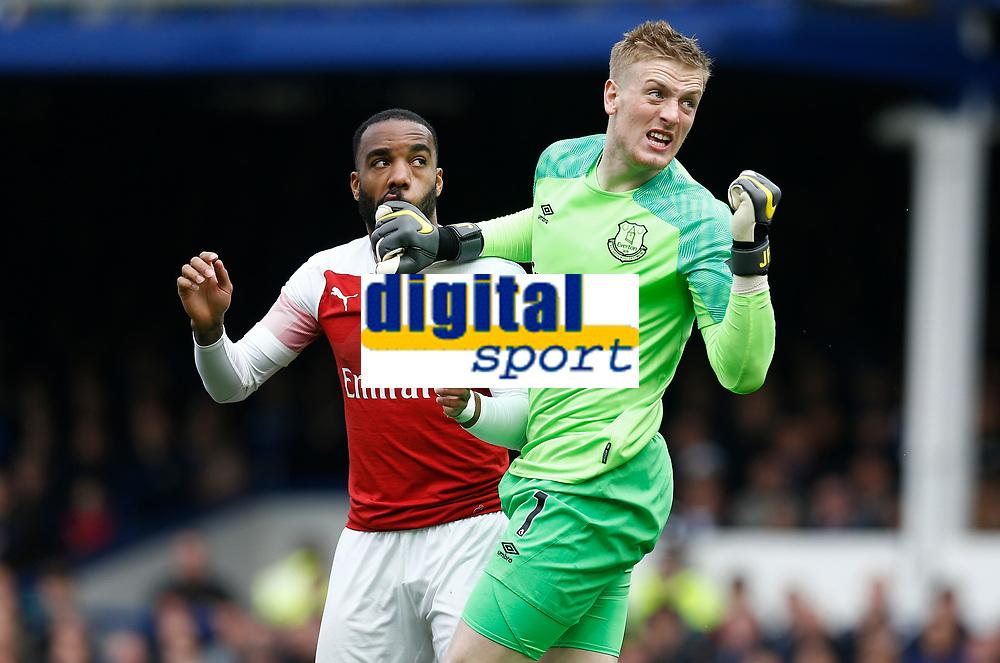 Football - 2018 / 2019 Premier League - Everton vs. Arsenal<br /> <br /> Alexandre Lacazette of Arsenal challenges Everton keeper Jordan Pickford, at Goodison Park.<br /> <br /> COLORSPORT/ALAN MARTIN