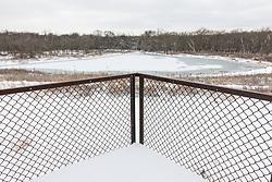 Trinity River Audubon Center pond after winter snowstorm, Dallas, Texas, USA.