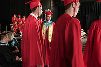 "Wearing his crown Jared Clough ""Mr. BHS"" along with fellow graduates line up to receive thier diplomas from Belmont High School during the commencement at Meadowbrook Pavillion Sunday morning.  (Karen Bobotas/for the Laconia Daily Sun)"