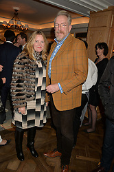 The COUNTESS OF ST.GERMANS and MICHAEL HOWELLS at a party to celebrate the publication of 'Let's Eat meat' by Tom Parker Bowles held at Fortnum & Mason, Piccadilly, London on 21st October 2014.