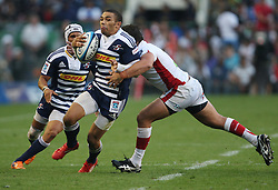 Brian Habana of the Stormers tries to slip the tackle of James Hanson of the Reds during the Super Rugby (Super 15) fixture between DHL Stormers and the Reds played at DHL Newlands in Cape Town, South Africa on 9 April 2011. Photo by Jacques Rossouw/SPORTZPICS