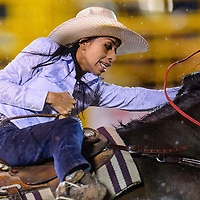 070415       Cable Hoover<br /> <br /> Barrel racer Ruby Holgate clings to her saddle as she rounds her final barrel during the PRCA Rodeo in Window Rock Saturday.