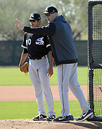 GLENDALE, ARIZONA - FEBRUARY 20:  Bernardo Flores Jr. is instructed by coach Curt Hasler #29 of the Chicago White Sox during spring training workouts on February 20, 2019 at Camelback Ranch in Glendale Arizona.  (Photo by Ron Vesely). Subject:   Bernardo Flores Jr.; Curt Hasler