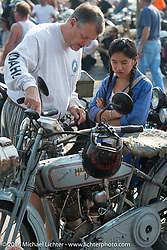 Locals check out the bikes on display at High Desert Harley-Davidson in Meridian, Idaho for the hosted dinner strop at the end of stage 13 (257 miles) of the Motorcycle Cannonball Cross-Country Endurance Run, which on this day ran from Elko, NV to Meridian, Idaho, USA. Thursday, September 18, 2014.  Photography ©2014 Michael Lichter.