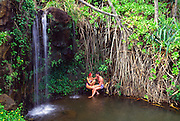 Couple under waterfall<br />