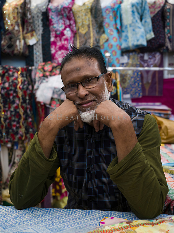 Atmospheric scenes of daily life from some of Doha's older neighbourhoods where the authentic Middle Eastern feel is still intact, for now. Abu Tahar of Bangladesh in his textiles shop near Musheireb old town.