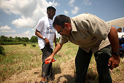 01 June 2010. New Orleans, Louisiana, USA.  <br /> Spike Lee's bodyguard Marco Umana applies the insect repellent to Spike Lee at the Breton Sound Marina in Hopedale for his latest movie,  'If God is Willing and da Creek Don't Rise.'<br /> Photo; Charlie Varley.