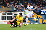 Bury's Duane Holmes has a shot blocked by Burton's John Mousinho. Skybet football league two match, Bury v Burton Albion at the JD Stadium, Gigg Lane in Bury, Lancs on Saturday 20th Sept 2014.<br /> pic by David Richards,  Andrew Orchard sports photography.