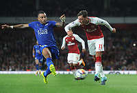 Football - 2017 / 2018 Premier League - Arsenal vs. Leicester City<br /> <br /> Mesut Ozil of Arsenal and Danny Simpson of Leicester  at The Emirates.<br /> <br /> COLORSPORT/ANDREW COWIE