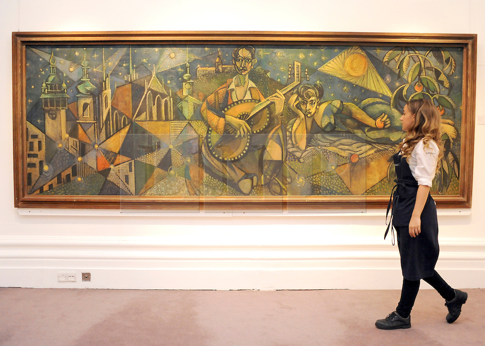 © licensed to London News Pictures. LONDON, UK.  09/06/11. An assistant walks in front of Nohumir Matal's the lovers estimated to fetch £12,000 - 18,000. Press preview for Sotheby's upcoming Sale of The Hascoe Family Collection of Important Czech Art. Highlights include a group of 20 paintings from Frantisek Kupka, including Movement, which is estimated to fetch £500,000 to £700,000 and Bohumil Kubi?ta's Still Life with Fruit of 1909, estimated at £300,000 to £500,000.  Photo credit should read Stephen Simpson/LNP