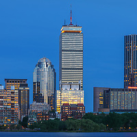 Boston skyline photography showing the Prudential Center, Sheraton Hotel Boston, 111 Huntington Avenue and the newly constructed One Dalton Tower office buildings and Four Season Hotel at twilight. <br />