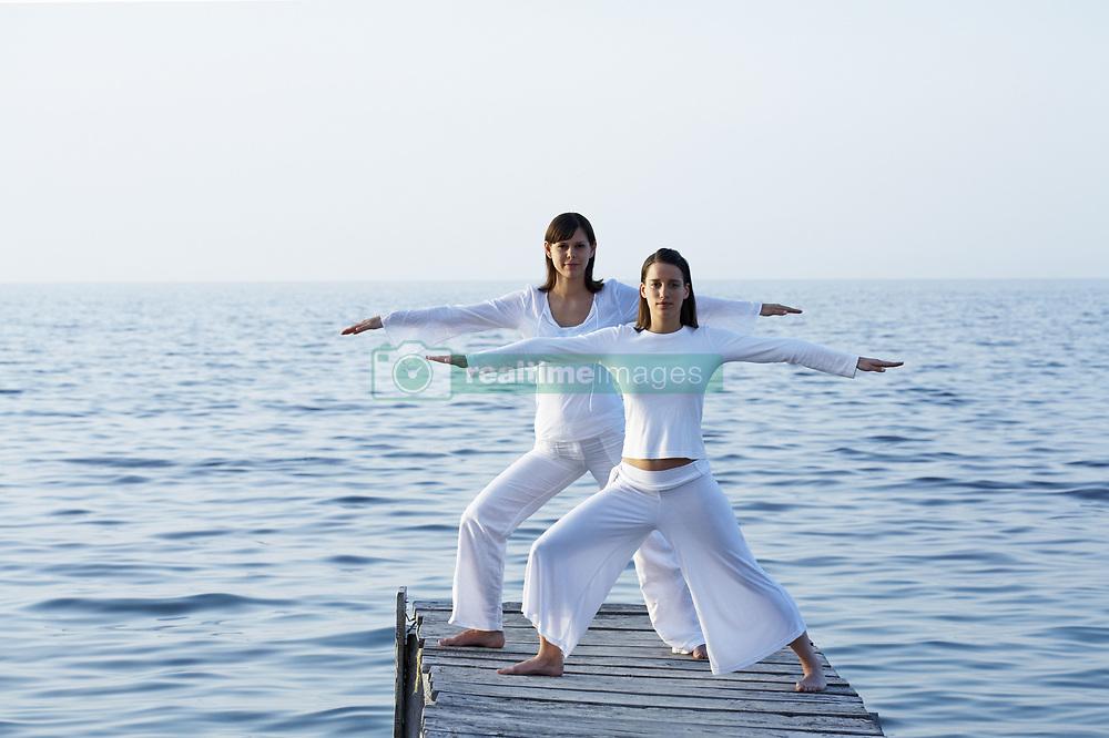 May 07, 2007 - Two women on dock doing yoga.. Model Released (MR) (Credit Image: © Cultura/ZUMAPRESS.com)