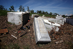 15 September 2012. Braithwaite, Plaquemines Parish, Louisiana,  USA. .Tombs from English Turn Cemetery were picked up and  smashed by hurricane Isaac. Many tombs were washed up on the levee, others scattered across the road. FEMA contractors came in and marked caskets in order that they may one day be reinterred, covering them with ubiquitous blue tarp for now..Photo; Charlie Varley.