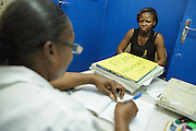 Community counselor from UNICEF partner NGO Femme Active Georgette Kakou Amoin discusses with Atche Yolande, 22, during a voluntary HIV screening visit at the Koumassi Grand Campement health center in Abidjan, Cote d'Ivoire on Thursday July 18, 2013. Yolande tested negative.