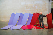 Phillip King with Nile 1967,Plastic laminated and glass reinforces plastic. Phillip King exhibition at the Tate Britain, to mark his 80th birthday. The display celebrates King's significant contribution to late 20th century sculpture through six colourful sculptures. These are his key works from the 1960s and include a variety of unusual shapes and forms, demonstrate King's experimentation with abstraction, construction, material and colour. They include iconic sculptures such as Genghis Khan 1963, a conical structure with a pair of antler-like forms and Rosebud 1962, his first coloured sculpture using fibreglass. The works are displayed in the grand surroundings of the Duveen galleries at Tate Britain.