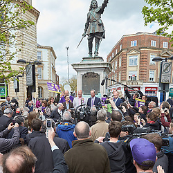 © Licensed to London News Pictures.  30/04/2015. AYLESBURY, UK. Nigel Farage (centre), UKIP party leader, gives a short speech in front of a statute of John Hampden, an parliamentarian who challenged the authority of the King ahead of the English Civil War, during a campaign visit to Aylesbury. <br /> <br /> Also in this picture: Chris Adams (centre left in light jacket), UKIP candidate for Aylesbury.<br /> <br /> Photo credit: Cliff Hide/LNP