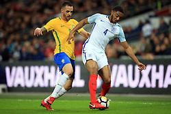 14 November 2017 -  International Friendly - England v Brazil - Joe Gomez of England in action with Renato Augusto of Brazil - Photo: Marc Atkins/Offside