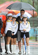 Racice, CZECH REPUBLIC. Members of the presentation party, shelter under an umbrella from the rain.  FISA Junior World Rowing Championships. Saturday,  07/08/2010.  [Mandatory Credit Peter Spurrier/ Intersport Images]