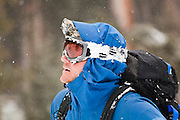 Backcountry skier Sterling Roop with goggles covered in snow, San Juan Mountains, Colorado.