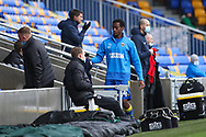 AFC Wimbledon attacker Zach Robinson (14) taking tracksuit off and about to come on as sub to make debut during the EFL Sky Bet League 1 match between AFC Wimbledon and Sunderland at Plough Lane, London, United Kingdom on 16 January 2021.