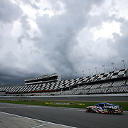 Austin Dillon makes a pass on pit row during the first practice session of the 56th Annual NASCAR Coke Zero400 race at Daytona International Speedway on Thursday, July 3, 2014 in Daytona Beach, Florida. A thunderstorm moved in and delayed the practice session. (AP Photo/Alex Menendez)