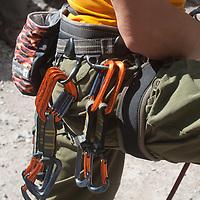 Rock climbers ascend Rundle rock near Banff in Banff National Park, Alberta, Canada.