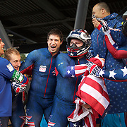 Winter Olympics, Vancouver, 2010.The USA-1 team of Steven Holcomb (centre), Justin Olsen, Steve Mesler and Curtis Tomasezicz win the Gold Medal in the Bobsleigh Four-man at The Whistler Sliding Centre, Whistler, during the Vancouver Winter Olympics. 27th February 2010. Photo Tim Clayton