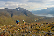Krissy Moehl and Luke Nelson trail running the Kings Trail, Swedish Lapland
