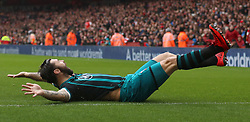 Southampton's Charlie Austin celebrates scoring his side's second goal of the game during the Premier League match at the Emirates Stadium, London.