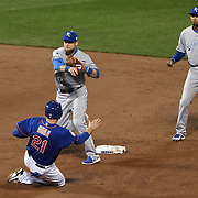 Ben Zobrist, Kansas City Royals, turns a double play as Lucas Duda, New York Mets, slides in to second base during the New York Mets Vs Kansas City Royals, Game 5 of the MLB World Series at Citi Field, Queens, New York. USA. 1st November 2015. Photo Tim Clayton