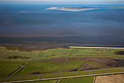 Nederland, Friesland, Gemeente Dongeradeel, 08-09-2009; Peazemerlannen, kweldergebied grenzend aan het Wierumerwad en de Waddenzeee. Het gebied is ontstaan door spontane uitpoldering bij storm in 1973 waarbij er een gat geslagen werd in de bitumendijk. Onder de zeedijk (op delta hoogte), diagonaal de zigzag lopende dijk van de zomerpolder. Het natuurgebied is in beheer bij  It Fryske Gea. Aan de horizon de Schiermonnikoog..Peazemerlannen, salt marshes bordering the Wierumerwad and Waddenzeee. The area has been created in 1973, a severe storm made a hole in the outside polder dike. Below the seawall (delta height),  in the middle the dike  of the summer polder. The area is a nature reserve, managed by It Fryske Gea.luchtfoto (toeslag); aerial photo (additional fee required); .foto Siebe Swart / photo Siebe Swart