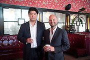 RICHARD CHANG; MAGNUS RENFREW, Brunch to celebrate the launch of Art HK 11. Miss Yip Chinese Cafe. Meridian ave,  Miami Beach. 3 December 2010. -DO NOT ARCHIVE-© Copyright Photograph by Dafydd Jones. 248 Clapham Rd. London SW9 0PZ. Tel 0207 820 0771. www.dafjones.com.
