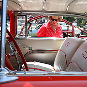 Sue Gonzales, of Toledo, takes a look in a 1955 Chevy Bel Air on display at the car show during the annual Maumee Summer Fair in Maumee, Ohio, on Saturday, August 11, 2018. THE BLADE/KURT STEISS
