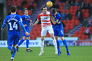 John Marquis wins a header during the EFL Sky Bet League 1 match between Doncaster Rovers and Rochdale at the Keepmoat Stadium, Doncaster, England on 1 January 2019.