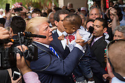 Billionaire Republican presidential candidate Donald Trump greets supporters at the South Carolina African American Chamber of Commerce annual meeting September 23, 2015 in Charleston, South Carolina.