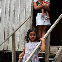 South America, Brazil, Amazon. Three young females give a glimpse of life in the Amazon.