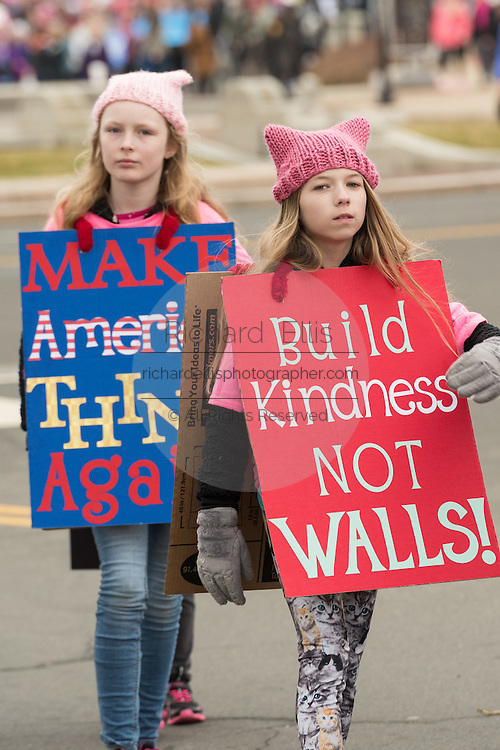 Young demonstrators walks with signs during the Women's March on Washington in protest to President Donald Trump January 21, 2017 in Washington, DC. More than 500,000 people crammed the National Mall in a peaceful and festival rally in a rebuke of the new president.
