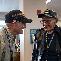 Moments before boarding, WWII US Navy Veterans James Keele, 94, left, and Lawrence Talamante, 94, share stories with one another in the terminal of the Albuquerque International Sunport in Albuquerque Jun. 05
