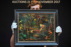 """© Licensed to London News Pictures. 17/11/2017. London, UK.  London, UK.  17 November 2017. A technician presents """"The Goldfish Pool at Chartwell"""", circa 1962, by Sir Winston Churchill (Est. GBP 50-80k), the final work Churchill ever painted.  Preview upcoming auctions of Modern & Post War British Art and Scottish Art taking place at Sotheby's, New Bond Street, on 21 and 22 November. Photo credit: Stephen Chung/LNP"""