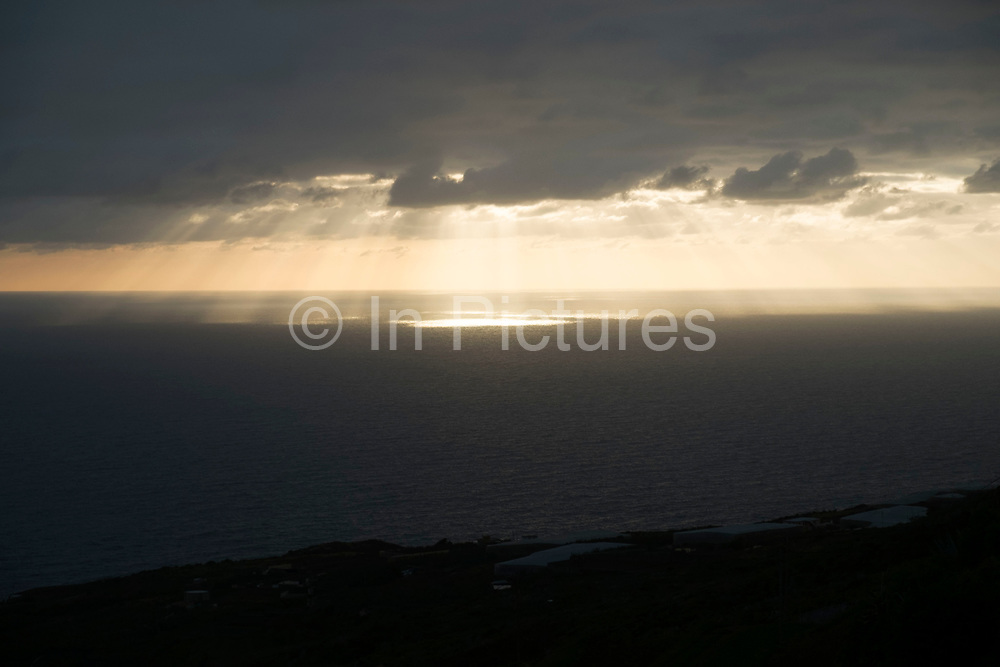 Sunlight dappling the sea at dawn sunrise at San Juan de Puntallana in La Palma, Canary Islands, Spain. La Palma, also San Miguel de La Palma, is the most north-westerly Canary Island in Spain. La Palma has an area of 706km2 making it the fifth largest of the seven main Canary Islands.